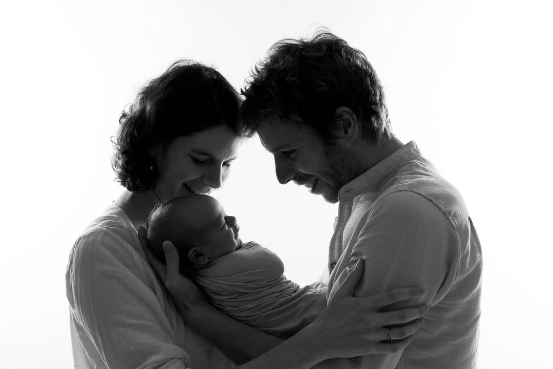 newborn photography baby with mom dad black and white