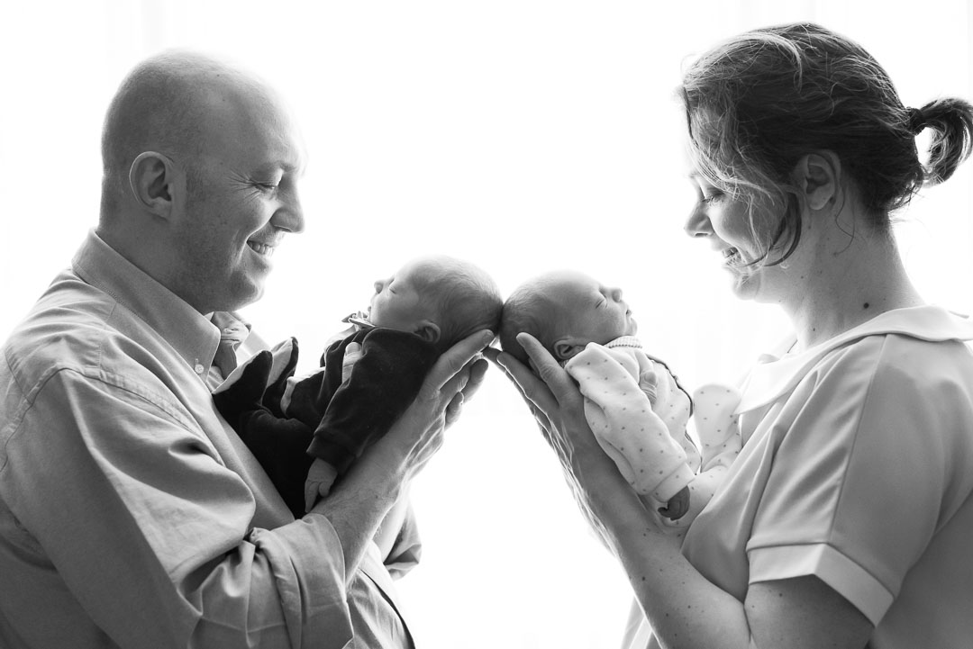 parents with twins at hospital newborn photography