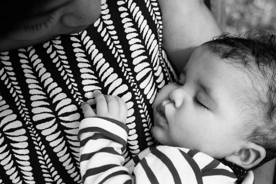 baby in moms hands sleeping