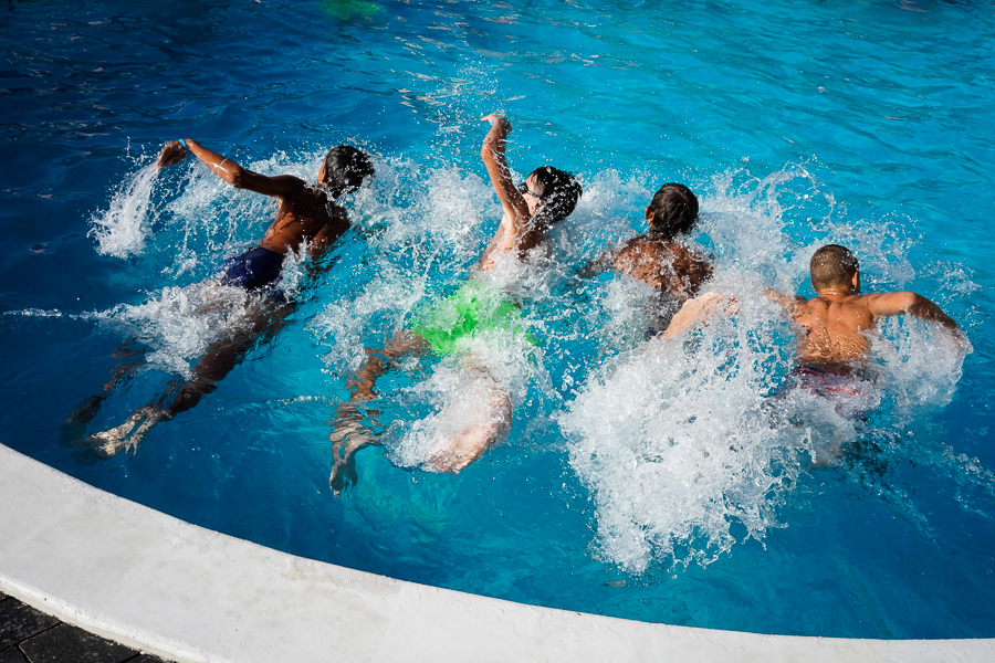 kids having fun in a pool summer